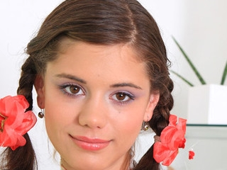 Pigtailed legal age teenager Caprice playing with her pink and soaked 18yo snatch on camera